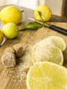 Fresh young lemons with cane sugar on the table Stock Photos