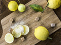 Fresh young lemons with sugar brown on the table Stock Photography