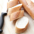 Freshly baked baguette sliced Stock Photography