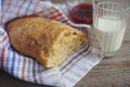 Freshly baked bread served with jam and glass of milk slice whole grain loaf a rustic wooden table top Royalty Free Stock Photography