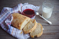Freshly baked bread served with jam and glass of milk slice whole grain loaf a rustic wooden table top Stock Image
