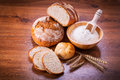 Freshly baked bread on wooden table Stock Photography