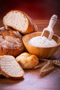 Freshly baked bread on wooden table Royalty Free Stock Photos