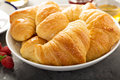 Freshly baked croissants in a bowl Royalty Free Stock Photo