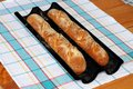 Freshly baked french baguettes in a baguette tray Stock Image