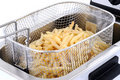 Freshly baked french fries in an electric frying p Royalty Free Stock Images