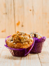 Freshly baked golden muffins for breakfast with nuts bran and muesli a healthy start to the day Royalty Free Stock Images