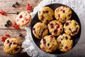 Freshly baked muffins with black and red currant berries close-up. Horizontal top view from above Royalty Free Stock Photo