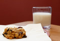 Freshly baked oatmeal raisin cookie with a glass of milk closeup Royalty Free Stock Images