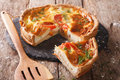 Freshly baked pie with feta cheese, tomatoes and herbs closeup. Royalty Free Stock Photo