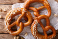 Freshly baked soft pretzel with generous sprinkling of coarse sa Royalty Free Stock Photo
