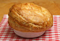Freshly baked steak pie resting on tea towel shallow dof focus at centre of image Stock Photo