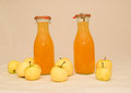 Freshly bottled homemade applejuice two bottles of stand surrounded by apples Stock Photography