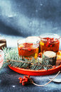 Freshly brewed tea in glass cup on blue background orange hot drink selective focus fresh herbal tea with tincture of red berri Royalty Free Stock Image