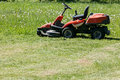 Freshly cut grass by red lawnmower Royalty Free Stock Photo