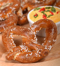 Freshly made German style pretzel with a cheddar cheese spread Royalty Free Stock Photo