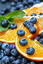Freshly picked blueberries with orange Royalty Free Stock Photo