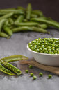 Freshly picked english peas on a wooden table Stock Photos