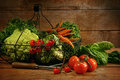 Freshly picked vegetables in basket on table Royalty Free Stock Photo