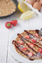 Freshly prepared crepes with strawberries Royalty Free Stock Photography