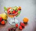 Freshly prepared fruit salad with fresh organic fruits Royalty Free Stock Photos