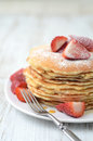 Freshly prepared pancakes with strawberries stack of traditional Royalty Free Stock Image