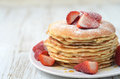 Freshly prepared pancakes with strawberries stack of traditional Royalty Free Stock Images