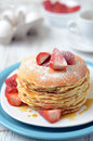 Freshly prepared pancakes with strawberries stack of traditional Stock Images