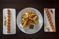 Freshly prepared sushi dish and tempura shrimp Royalty Free Stock Photo