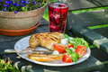 Freshly served barbeque dinner in the garden summer Royalty Free Stock Image