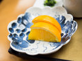 Freshly sliced oranges on traditional japanese plate Royalty Free Stock Photo