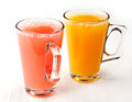 Freshly squeezed juice orange and red grapefruit Stock Images