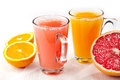 Freshly squeezed juice orange and red grapefruit Royalty Free Stock Images
