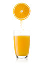 Freshly squeezed orange juice directly from the fruit Stock Photos