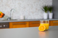 Freshly squeezed orange juice in kitchen modern Royalty Free Stock Photo