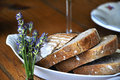 Freshly traditional bread in rural setting with lavender Royalty Free Stock Photography