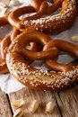 Freshly traditional pretzels with salt close up on the paper. ve Royalty Free Stock Photo