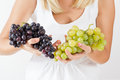 Freshness red grapes closeup of grape in woman hands Royalty Free Stock Images