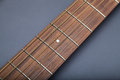Fretboard on Acoustic Guitar Close-Up on Fifth Fret Royalty Free Stock Photo