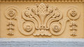 Fretwork on the building wall. Royalty Free Stock Photo