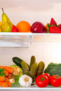 Fridge full healthy fruits vegetables Stock Images