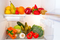 Fridge full healthy fruits vegetables Royalty Free Stock Photos