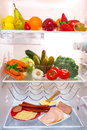 Fridge full healthy fruits vegetables sandwich ingredients Stock Image