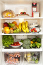 Fridge full of healthy products Stock Photos
