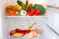 Fridge full healthy vegetables ham cheese Royalty Free Stock Photo