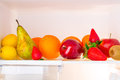 Fridge shelf full healthy fruits Royalty Free Stock Images