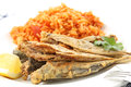 Fried Atlantic horse mackerel with tomato rice-portuguese tradit Royalty Free Stock Photo