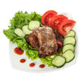 Fried beef meat with vegetable garnish isolated on white background Royalty Free Stock Photos