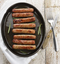 Fried breakfast sausage links on a pan Stock Images