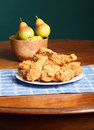 Fried chicken on blue placemat and bowl of pears a plate crispy a white plate a plaid with a wood fresh Stock Photo
